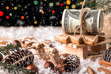 Money Christmas  Gift with wooden sled. Christmas concept