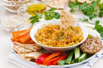 Arabic sauce hummus with fresh vegetables and pita bread
