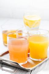 fresh citrus juices in assortment, vertical