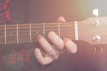 Musician Playing accord Dm on acoustic guitar, close up