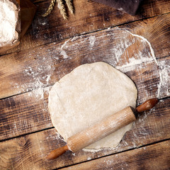 Fototapete - Roll out dough with rolling pin and flour