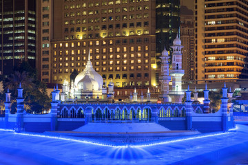 Masjid Jamek (Mosque) or Masjid India with blue light by river of life show at night, Kuala Lumpur, Malaysia