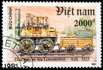 Old postage stamp with retro steam german locomotive and railway, printed in Vietnam in 1991