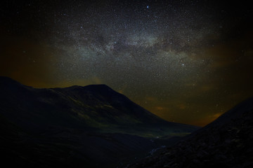 Stars in the night sky over the mountains. View of the Milky Way.