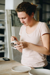 Woman Working At Pottery Studio
