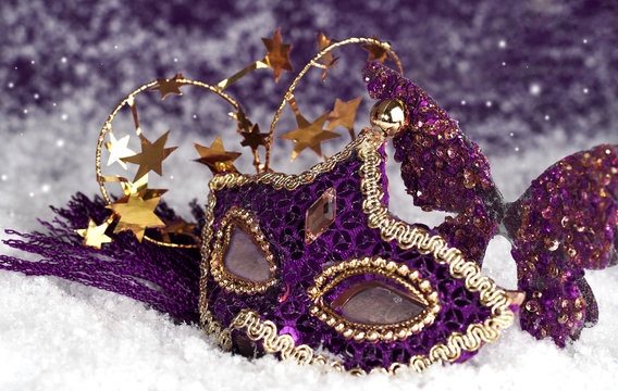 purple carnival mask in the snow