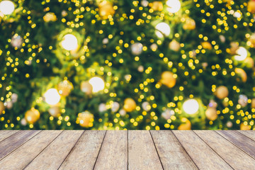Abstract Christmas holiday bokeh light background with empty wood table for create montage product