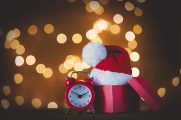 Vintage alarm clock with Santa Claus hat