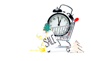 Image of trolley with golden alarm clock, Christmas tree, greeting card, ribbon