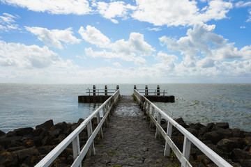 Jetty and clouds