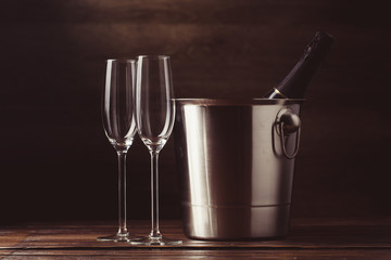 Picture of two empty wine glasses, bottle of wine
