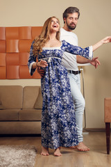 Photo of dancing man and long-haired blonde in homemade clothes