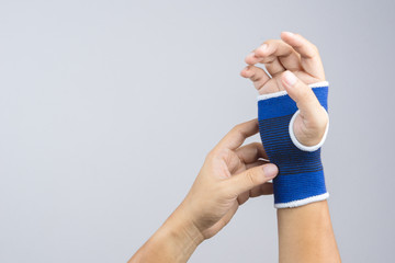 Hand with elastic wrist support and hurt gesture