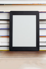 Blank black picture frame next to books