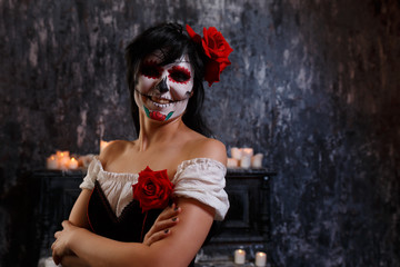Halloween picture of smiling zombie woman with makeup