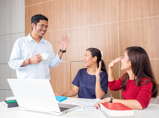 Group of asian business people say hi/good bye each other in the morning in office, good morning, say hi/good bye in office concept