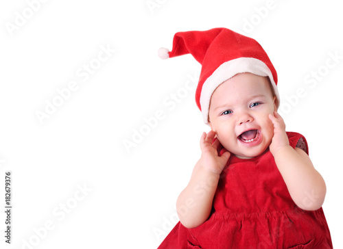 1b1e372b5cf Baby in santa hat isolated on white.