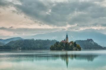 Church on island in Lake Bled n sunrise, Slovenia