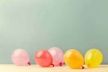 Colorful shiny balloons on blue