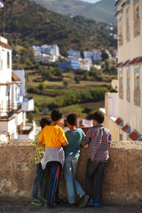 Children looks at cityscape standing on the old street of Morocco