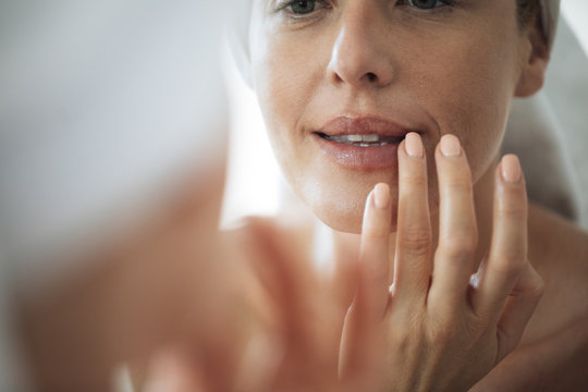 Woman Touching Her Lips