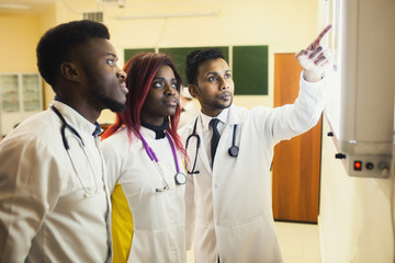 A group of black medical students examines an X-ray. mixed race of future trauma doctors