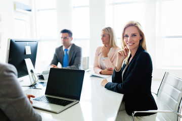 Picture of attractive saleswoman on meeting in office