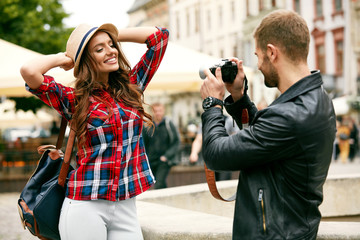Couple In Love. Man Taking Photos Of Beautiful Woman In Street.