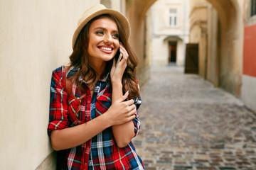 Tourist Woman Talking On Phone While Walking Around Street.