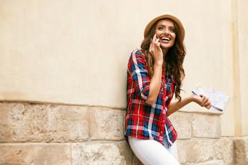 Beautiful Tourist Girl Talking On Phone Outdoors.