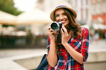 Beautiful Tourist Girl With Camera In Hands.