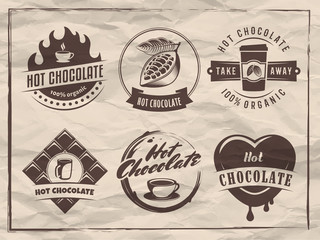 Vector hot chocolate logos. Cacao drink badges. Set of retro stickers for cafe, bar or restaurant on vintage paper background