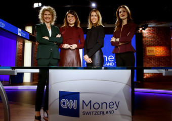 Anchor women Ana Maria Montero, Hannah Wise, Amanda Kayne and Martina Fuchs of CNNMoney Switzerland pose for pictures after a news conference in Zurich