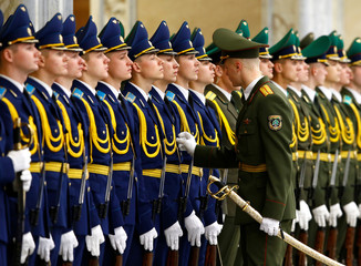 Members of the honor guard prepare before the meeting of Belarussian President Alexander Lukashenko with his Kazakh counterpart Nursultan Nazarbayev at the Independence Palace in Minsk