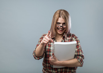 Young attractive woman in glasses hold book