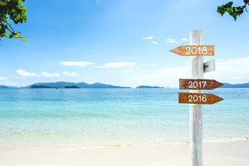 Wooden Sign with 2018, 2017, 2016 text for New year holiday decoration advertising.