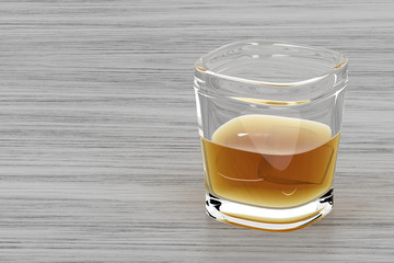 Glass of whisky on wood background