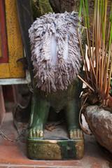Hidden dog or dragon statue in Vientiane