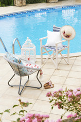 poolside home concept with decorative chairs