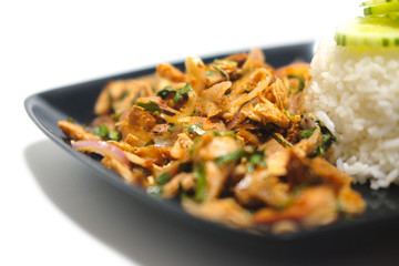 Spicy roasted chicken with rice in black dish