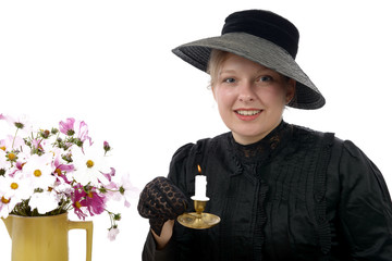 young woman in vintage costume 1900s with candle