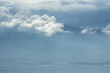 Clouds, mountain and water - a gentle landscape in blue