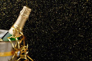 Bottle of champagne in a bucket on dark backgroud. Copy space