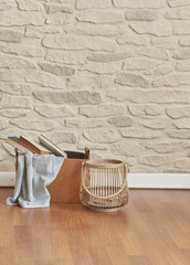 wicker bag blanket and vase with stone wall brick wall concept