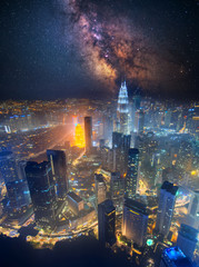 Foto op Aluminium Kuala Lumpur Aerial skyline view to Kuala Lumpur city, Malaysia. Cityscape business skyscrapers night downtown and Milky Way galaxy on sky