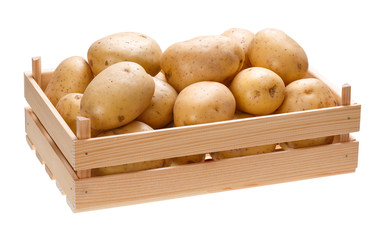 Potato tubers in a wooden box. Isolated on white background.