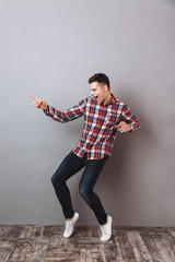 Full length image of Happy man in shirt and jeans