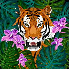 Portrait of a tiger in green undergrowth and flowers