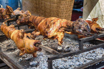 A whole lamb being roasted on a fire