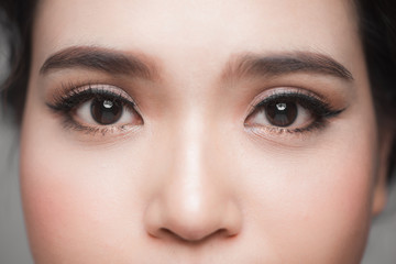 Asian model eye close-up with long eyelashes. Selective focus